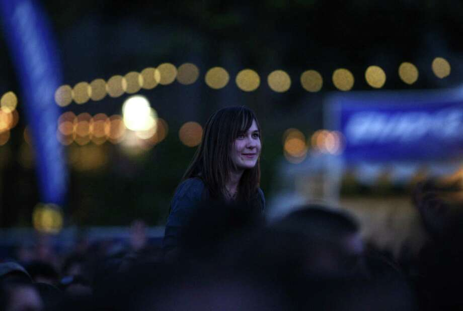 A fan watches as musician Lights performs on the Fisher Green Stage. Photo: JOSHUA TRUJILLO / SEATTLEPI.COM
