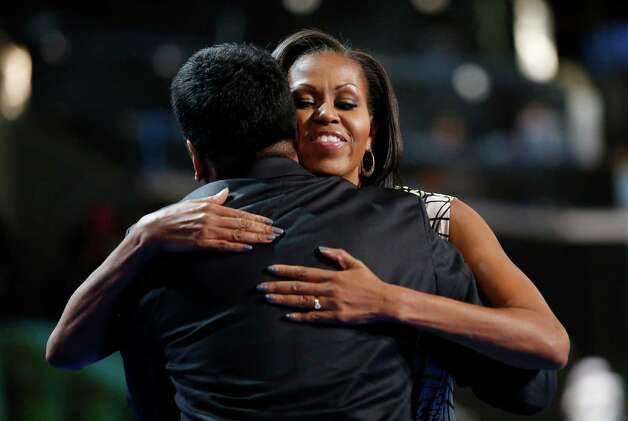 First Lady Michelle Obama hugs actor Kal Penn after filming a campaign video at the Democratic National Convention inside Time Warner Cable Arena in Charlotte, N.C., on Monday, Sept. 3, 2012. (AP Photo/Jae C. Hong) Photo: Jae C. Hong