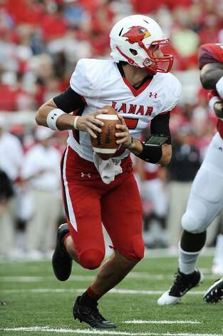 Lamar quarterback Ryan Mossakowski drops back to complete a pass to Barry Ford against Louisiana-Lafayette at Lafayette on Saturday, September 1, 2012. Photo taken: Randy Edwards/The Enterprise Photo: Randy Edwards, Photojournalist / Enterprise