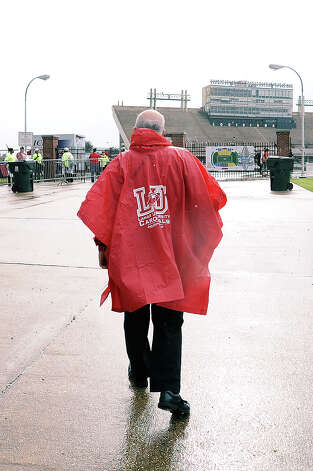 Lamar fans show their Cardinal spirit rain or shine against the Louisiana-Lafayette at Lafayette on Saturday, September 1, 2012. Photo taken: Randy Edwards/The Enterprise Photo: Randy Edwards, Photojournalist / Enterprise