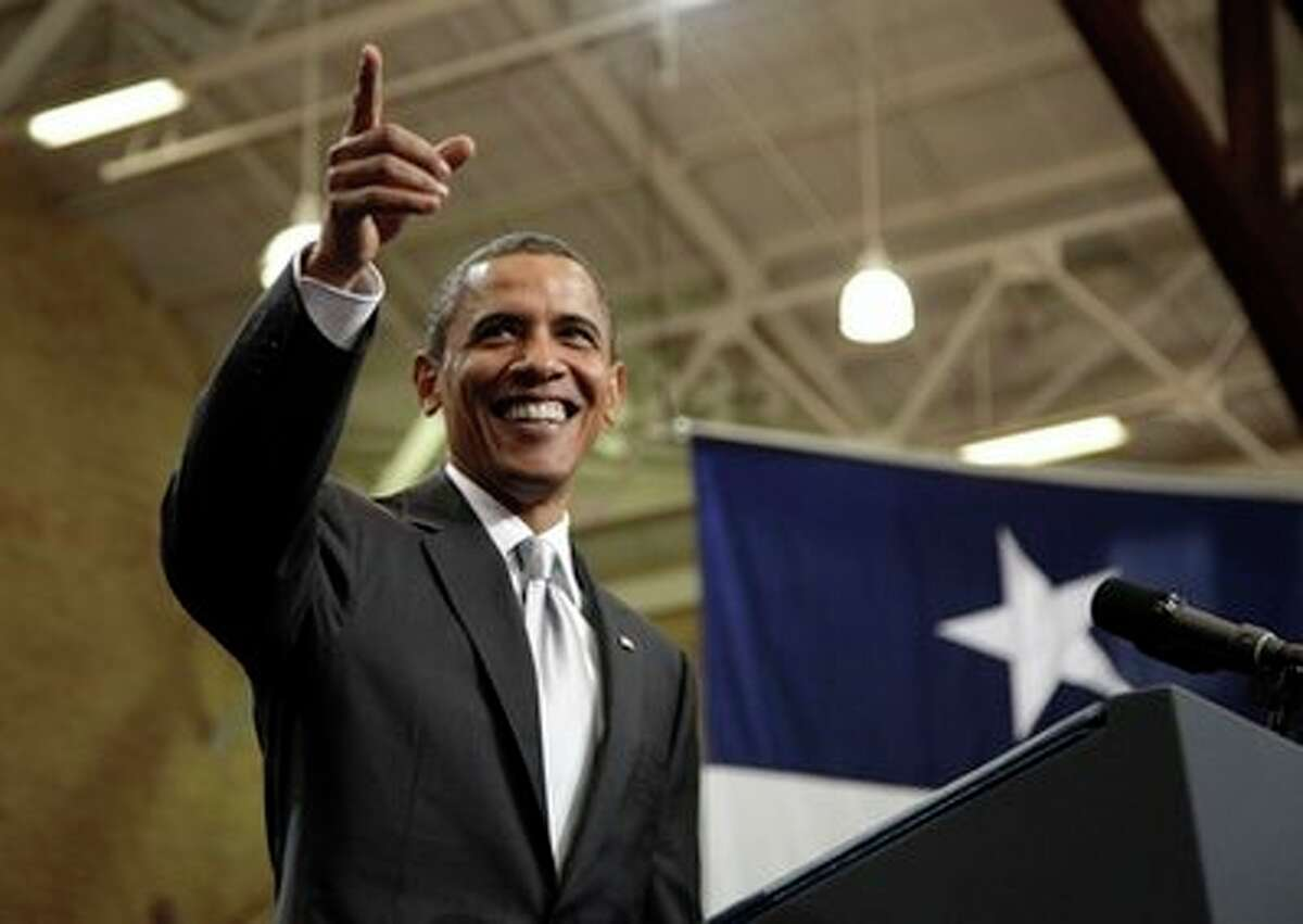 President Barack Obama gestures to the crowd as he arrives at the University of Texas in Austin, Texas, Monday, Aug. 9, 2010. (AP Photo/Carolyn Kaster) (AP)