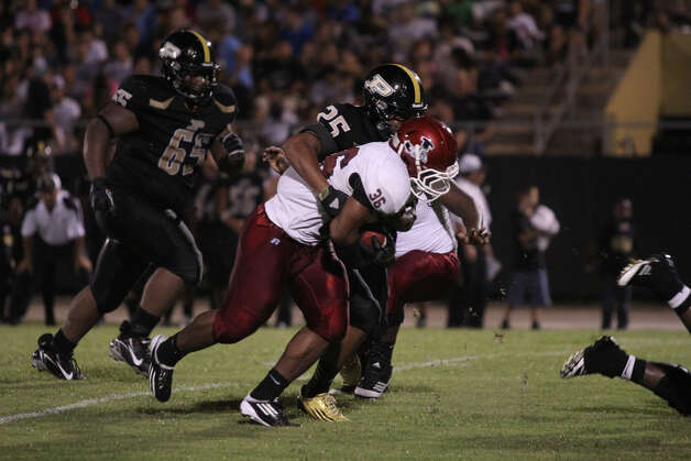 Terrance Cuney breaks away from Liberty defenders. Photo: Jason Dunn