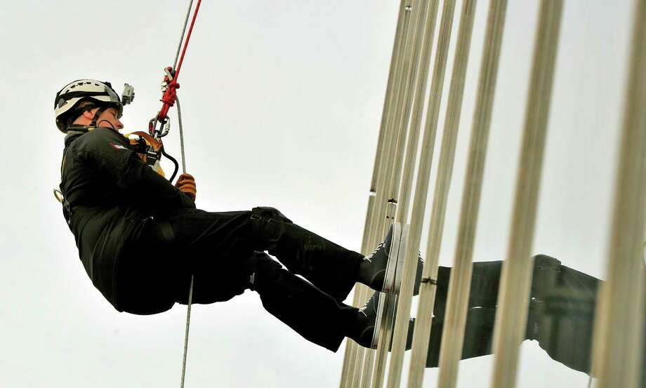 Britain's Prince Andrew abseils down The Shard, the tallest building in Europe, for charity in central London Monday, Sept. 3, 2012. The 52-year-old royal descended the Shard skyscraper in London, beginning his daredevil stunt from the 87th floor - just below the top of the 1,016ft tower - and finishing half an hour later on level 20. Prince Andrew trained with the Royal Marines in Arbroath, Scotland over the summer to prepare for the challenge. (AP Photo/Max Nash/PA Wire)  UNITED KINGDOM OUT NO SALES NO ARCHIVE Photo: Max Nash, AP / PA