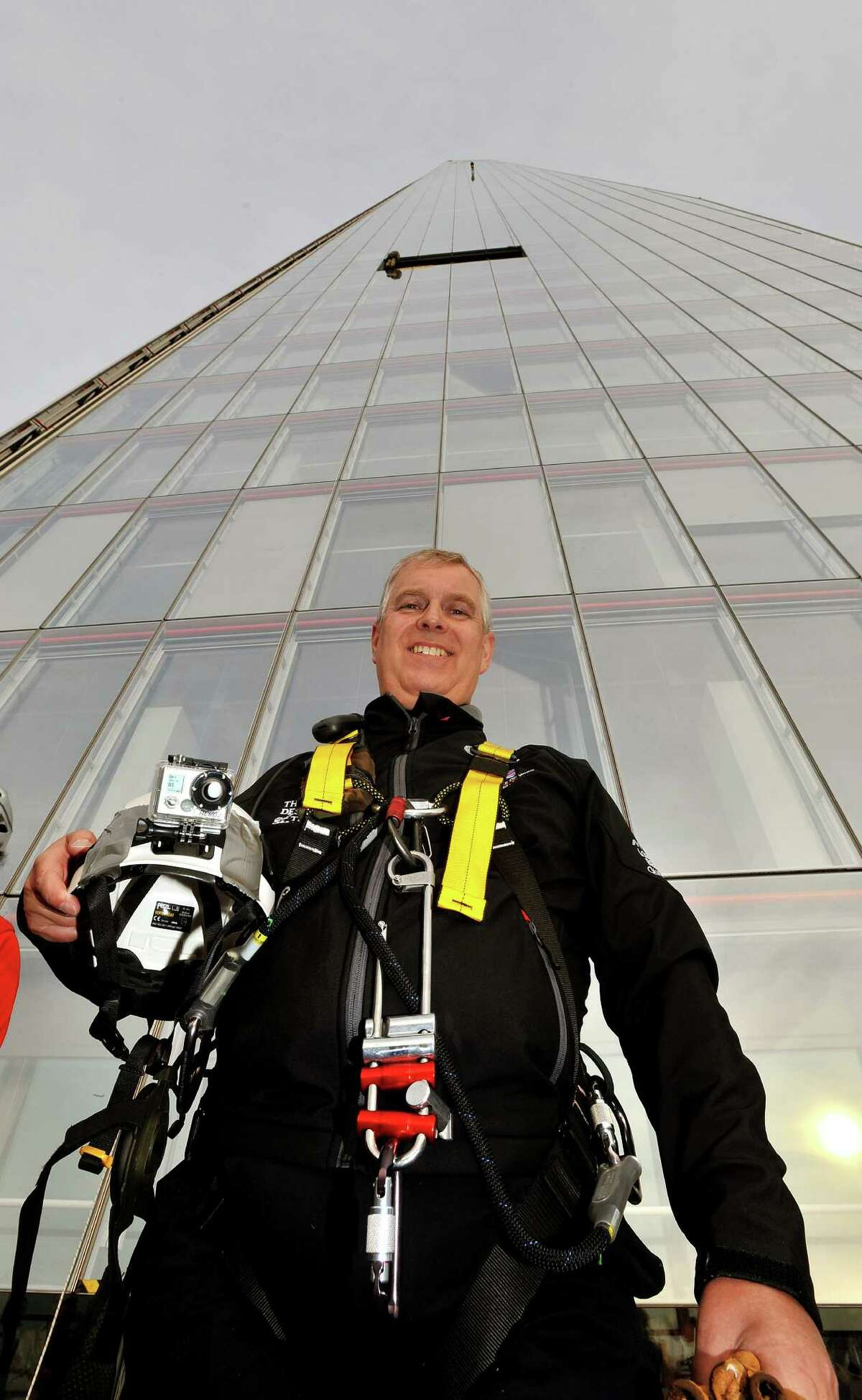 LONDON, UNITED KINGDOM - SEPTEMBER 03: Prince Andrew, Duke of York stands in front of the south east face after abseiling down the Shard to raise money for charity on September 03, 2012 in London, England. The Prince joined with 40 other people in abseiling down the tallest building for the educational charity The Outward Bound Trust and the Royal Marines Charitable Trust Fund.