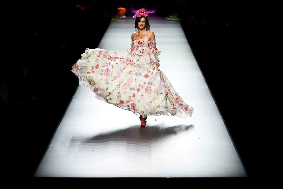 A model displays a Spring/Summer design by Francis Montesinos during Madrid's Mercedes Benz Fashion Week, in Madrid, Friday, Aug. 31, 2012. Photo: Daniel Ochoa De Olza, AP / AP