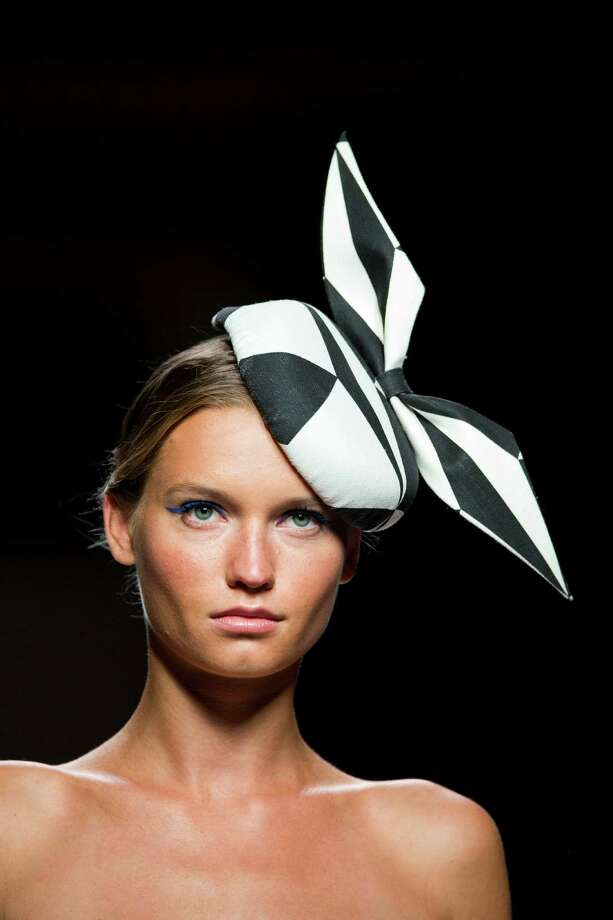 A model displays a Spring/Summer design by Ion Fiz during the Madrid's Mercedes Benz Fashion Week, in Madrid, Sunday, Sept. 2, 2012. Photo: Daniel Ochoa De Olza, AP / AP