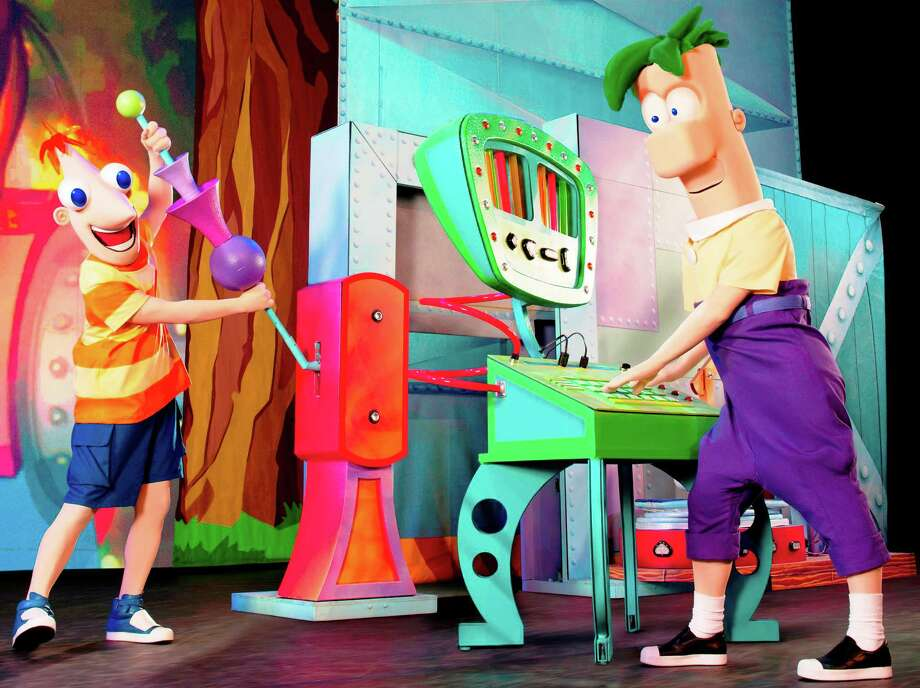 "Phineas (left) and Ferb try out their ideamashup machine in ""Phineas and Ferb: The Best Live Tour Ever!"" Photo: Courtesy Feld Entertainment"