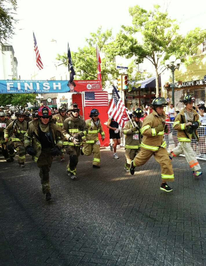 Firefighters run in the 2011 Tunnel to Towers Run downtown. Photo: Courtesy Photo