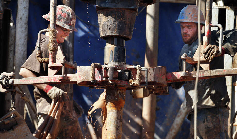 In this Tuesday, Feb. 21, 2012 photo, oil field workers drill into the Gypsum Hills near Medicine Lodge, Kan. An emerging oil boom has been sparked by modern technologies using horizontal drilling and a technique known as hydraulic fracturing, or ìfracking,î to coax out oil and gas. The potential production from the Mississippian Lime formation here - and its impact on domestic energy supplies - remains uncertain. But the use of the technology to unlock energy supplies previously unavailable in the United States is now in play in places like Pennsylvania, Wyoming, Colorado, New Mexico, Texas, Oklahoma and Louisiana. (AP Photo/Orlin Wagner) Photo: Orlin Wagner, Associated Press / AP