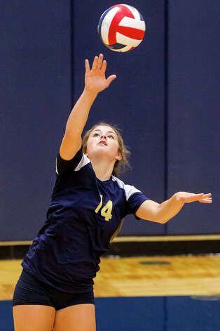 O'Connor senior middle blocker Kristin Fording gets off a serve during their match at Paul Taylor Field House on Aug. 28, 2012.   Photo by Marvin Pfeiffer / Prime Time Newspapers Photo: MARVIN PFEIFFER, Marvin Pfeiffer / Prime Time New / Prime Time Newspapers 2012