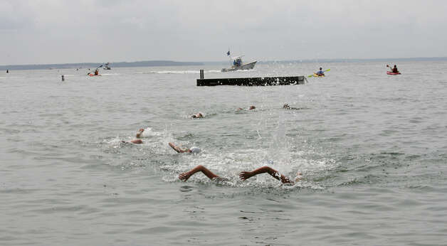 Swimmers compete at the annual Arthur J. Ladrigan Swim Races and Family Fun Day at Bayley Beach in Rowayton, Conn. on Sunday, September 2, 2012. Photo: Unknown, B.K. Angeletti / Connecticut Post freelance B.K. Angeletti