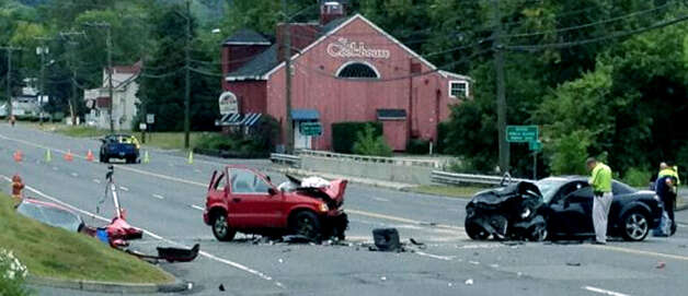 Two cars collided head-on on Danbury Road (Route 7 South) in New Milford during rush-hour traffic Tuesday morning. Both drivers, Elizabeth Burwell of New Milford and Reginald DeSouza of Danbury, were hospitalized in Danbury with serious injuries. Sept. 4, 2012  Photo by Lisa Weir Photo: Contributed Photo