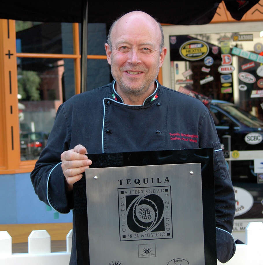 "Dallas ""Paul"" Mauk, chef and owner of Tequila Mockingbird, holds the CRT Award T certification plaque his establishment recently received. Photo: Contributed"