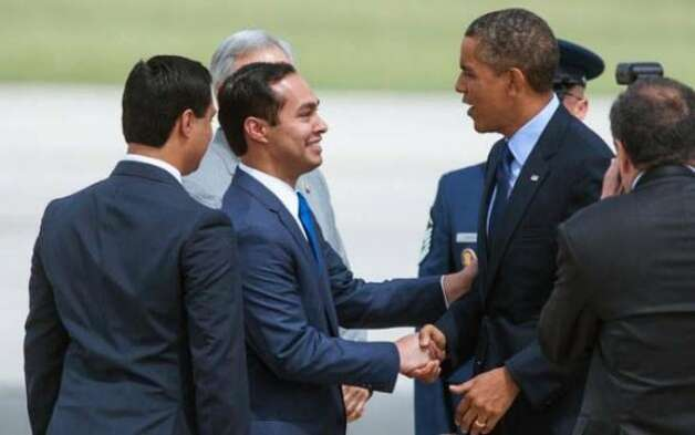 Julian Castro (in the blue tie) shakes hands with President Obama on July 17. The San Antonio mayor is flanked by his twin brother Joaquin. (Bahram Mark Sobhani / AP)