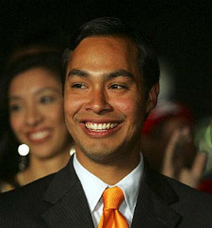 Julian Castro smiles as an audience applauds him. (San Antonio Express-News)