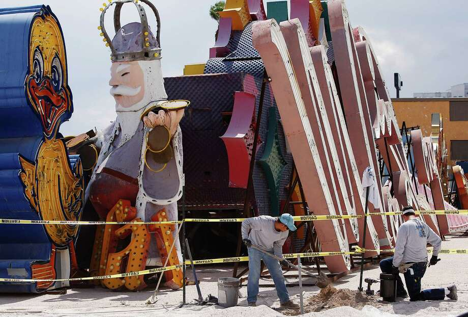 Electricians install the base of a lighting fixture on the grounds of the soon-to-open Neon Museum in Las Vegas. Photo: Jason Bean, Las Vegas Review-Journal / Las Vegas Review-Journal