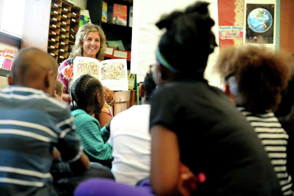 Fourth-grade teacher Lisa Fruscio reads