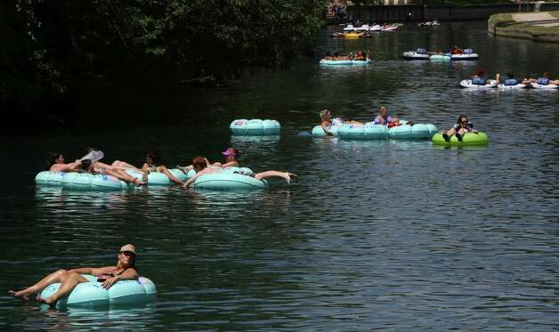 Tubers float down the Comal River in New Braunfels on Thursday Aug. 1, 2013. Photo: Helen L. Montoya, San Antonio Express-News / ©2013 San Antonio Express-News