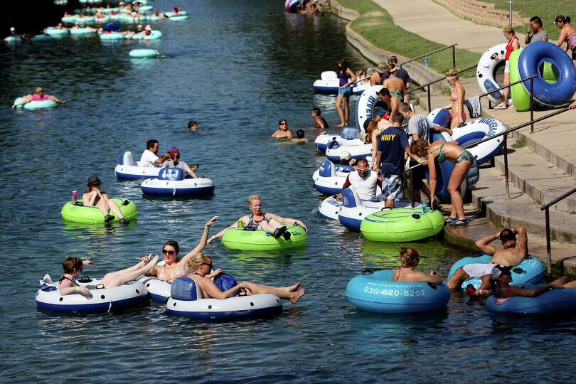 Tubers hit the Comal River in New Braunfels on Monday Sept. 3, 2012.