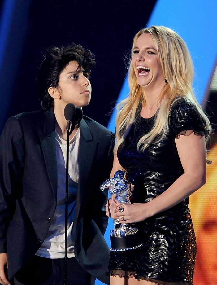 2011: Lady Gaga strikes again. She performed as her male alter ego, Jo Calderone, and then proceeded to stay in character for the rest of the show. Here, Jo presents the Best Pop Video award to singer Britney Spears. Photo: Kevin Winter, Getty Images