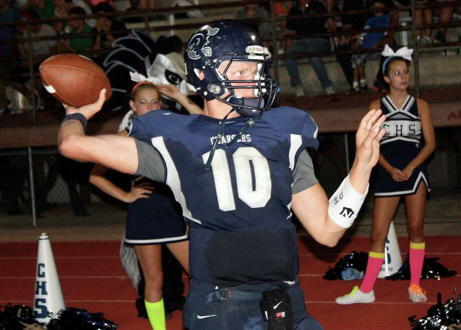 Boerne Champion quarterback Kyle Poeske put on a spectacular display against New Braunfels, completing 65-percent of his 60 pass attempts for 561 yards and six touchdowns, with no interceptions. The 6-2 senior also rushed 16 times for 71 yards as the Chargers pulled ahead of the Unicorns 41-14 at halftime before going on to win 44-34. Photo: Picasa, Mike Reeder / For The Northwest