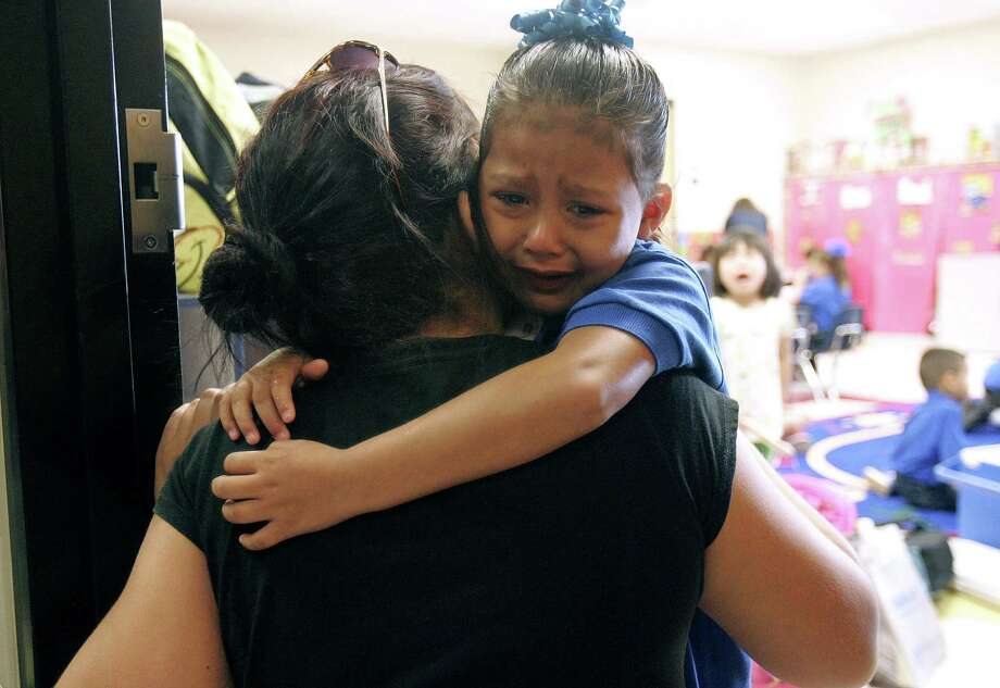 Erica Gonzalez cries and hugs her mother Rebekah Rodriguez as she attends her first day of prekindergarten on Aug. 27 at Aida C. Escobar Elementary School in Pharr, Texas. Photo: AP