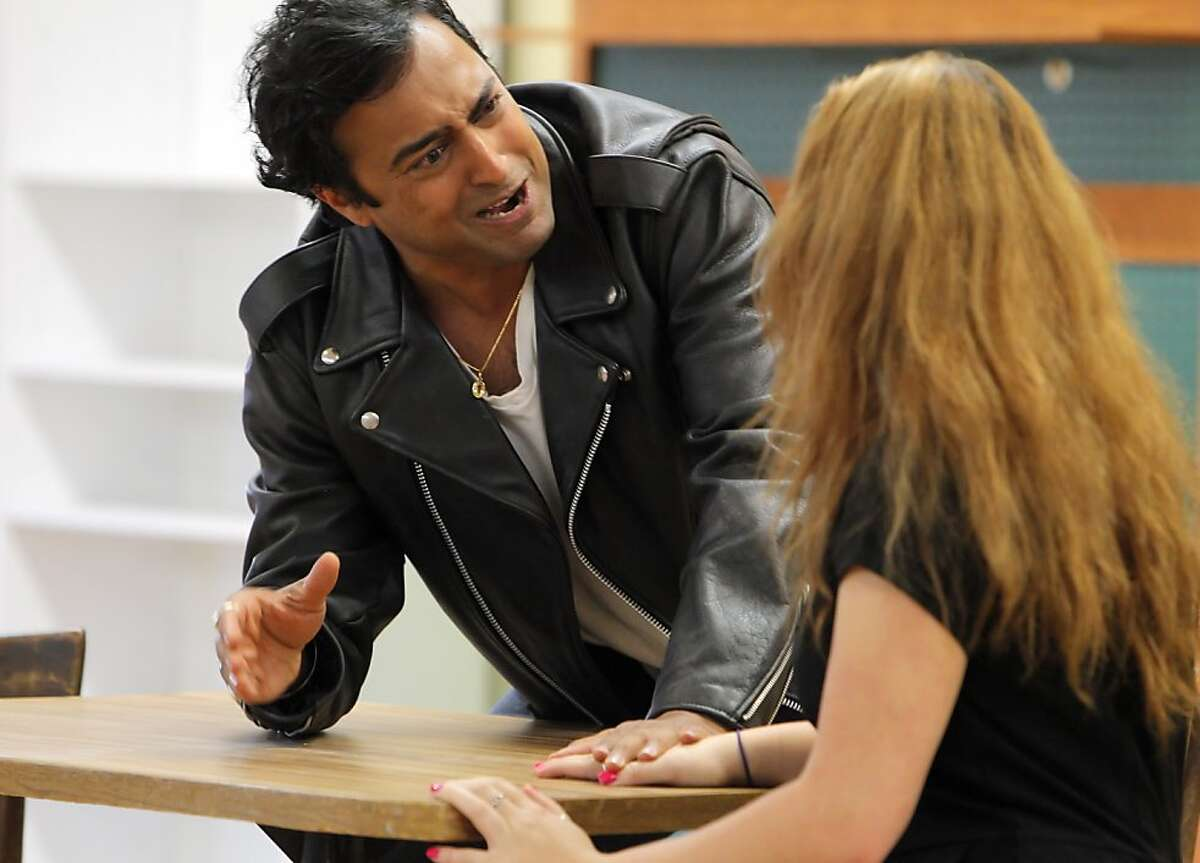 """Abhi Katyal as Petruchio, left, and Lindsay Styler as Kaharina, right, rehearse for their debut show of Half Moon Bay Shakespeare's """"The Taming of the Shrew"""" directed by artistic director Robert Pickett in Half Moon Bay, Calif., on Sunday, August 26, 2012."""