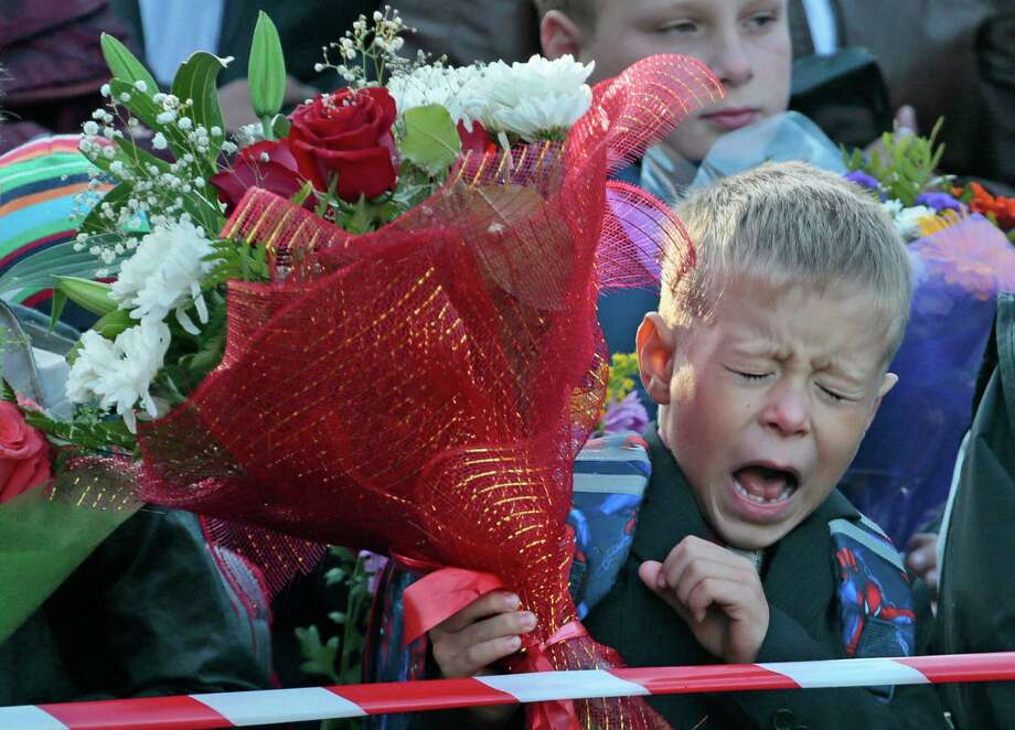 Here's a Russian child bored, or something, by the ceremony marking the start of classes at School No. 507 in Moscow on Sept. 1. Russia is one of many countries with elaborate ceremonies on the first day of school. Photo: AP