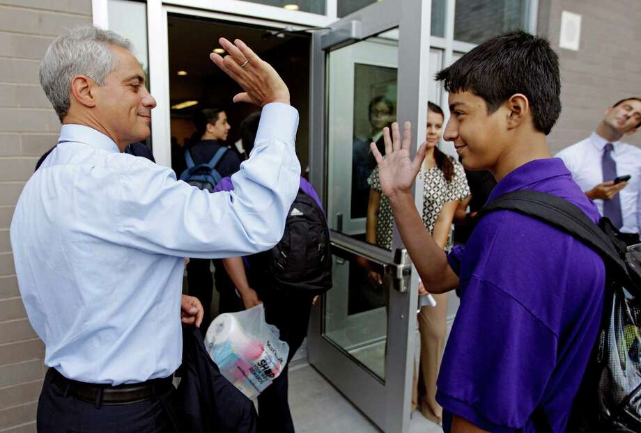 Chicago Mayor Rahm Emanuel gives an arriving student a high five at Shields Middle School on the first day, which was Tuesday. Photo: AP