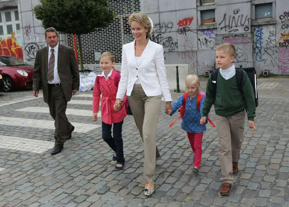 Princess Mathilde of Belgium leads children (from left) Princess Elisabeth, Princess Eleonore and Prince Gabriel to their first day at school at Sint Jan Berghmans College on September 3, 2012 in Brussels, Belgium. Photo: Mark Renders, Getty Images / 2012 Getty Images