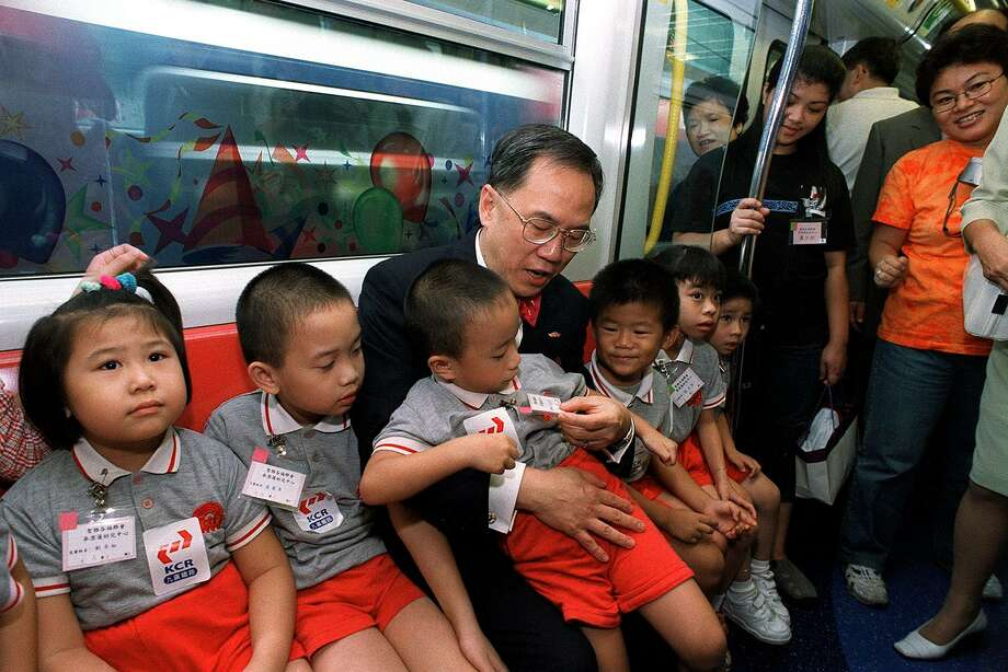 Politicians can't resist the lure of the first day of school. Here, Hong Kong Chief Secretary Donald Tsang Yam-kuen interacts with children during the inaugural run of a new KCRC train on Sept. 5, 2001, the first day of school in the Chinese territory. Photo: DANTE PERALTA, AFP/Getty Images / 2011 AFP