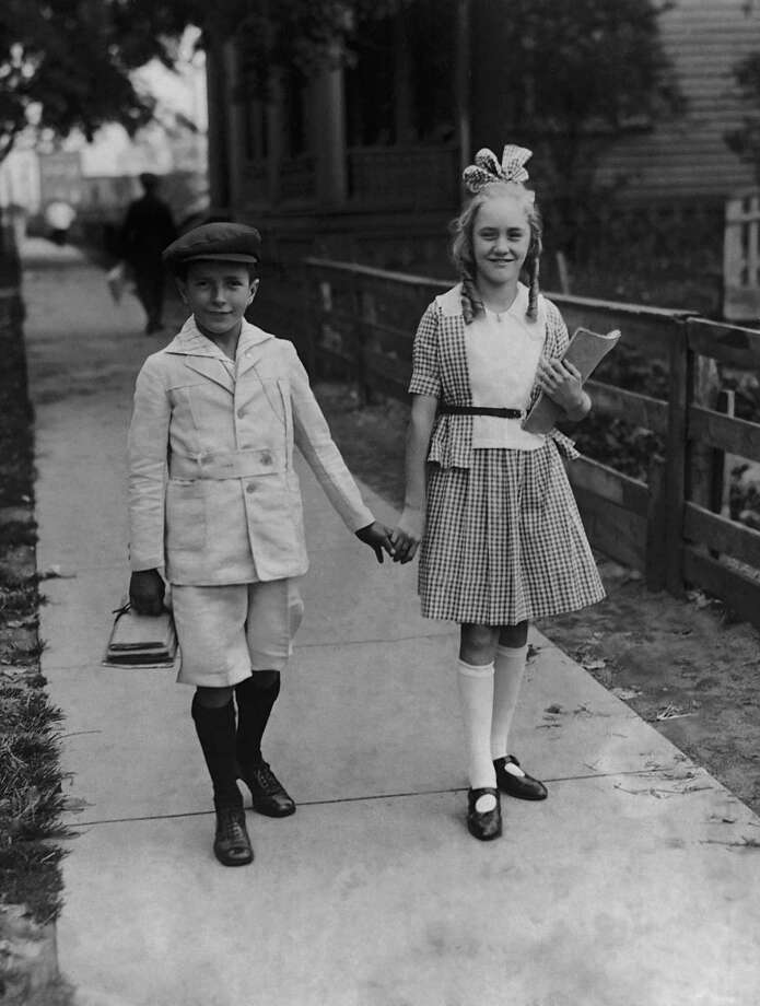 First, of course, you have to get to school. This boy and girl were on their way to the first day of classes in this picture, circa 1920. Photo: FPG, Getty Images / 2011 Getty Images