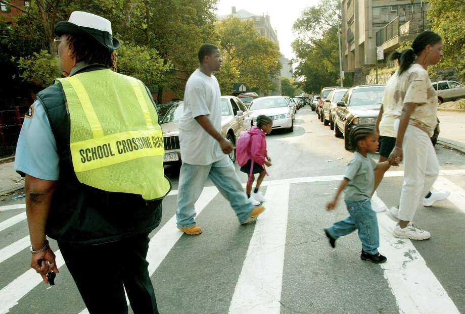 Fast forward to Sept. 8, 2003, when crossing guard Shirley Miller was photographed helping parents and their children through an intersection on Amsterdam Avenue on the first day back to school for New York City public school students. Photo: Monika Graff, Getty Images / 2003 Getty Images