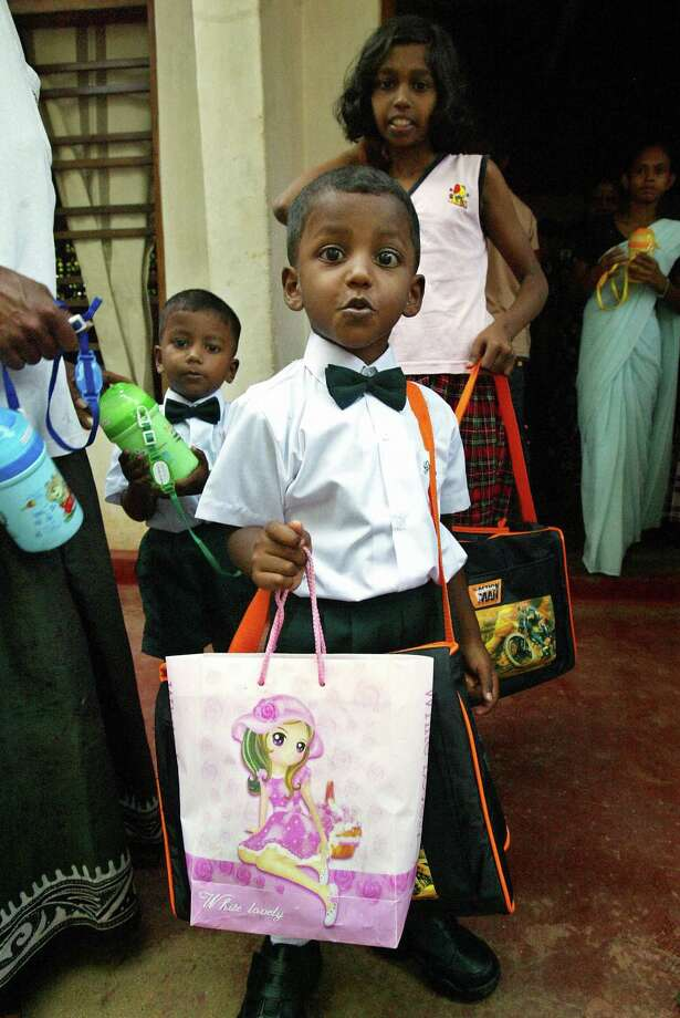 In many parts of the world, children dress up for school, particularly on the first day. Here are  Sri Lankan children showing up for the first day of a new Montessori kindergarten in the southwestern coastal town of Patuwatha on Jan. 7, 2005. Photo: JIMIN LAI, AFP/Getty Images / 2005 AFP