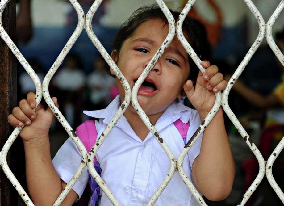 A girl cries in her first day of classes in Managua, Nicaragua, on February 2, 2010. Photo: ELMER MARTINEZ, AFP/Getty Images / 2010 AFP