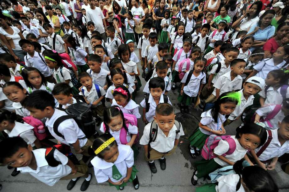 Once all the ceremonies are over, it's time to line up and get to class. Here, students line up before the start of the first day at an elementary school in Manila, the Philippines, on June 15, 2010. Photo: NOEL CELIS, AFP/Getty Images / 2010 AFP