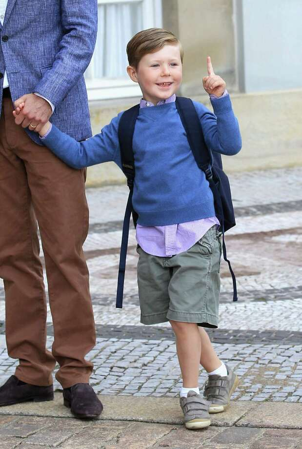 Even young princes and princesses have to go to school. Here, Prince Christian of Denmark greets onlookers as he heads to his first day of School at Amalienborg Royal Palace on August 12, 2011 in Copenhagen, Denmark. Photo: Chris Jackson, Getty Images / 2011 Getty Images