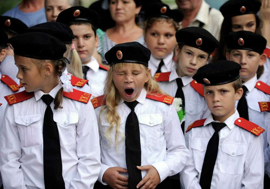 A student cadet yawns during a ceremony on the first day of school in the southern Russian city of Gelendzhik on Sept. 1, 2011. Photo: MIKHAIL MORDASOV, AFP/Getty Images / 2011 AFP