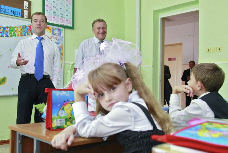 At least one child seemed completely uninterested in what then Russian President Dmitry Medvedev (left) had to say on Sept. 1, 2011, the first day of school in Verkhnerusskoye, in the Stavropol region. Photo: DMITRY ASTAKHOV, AFP/Getty Images / 2011 AFP