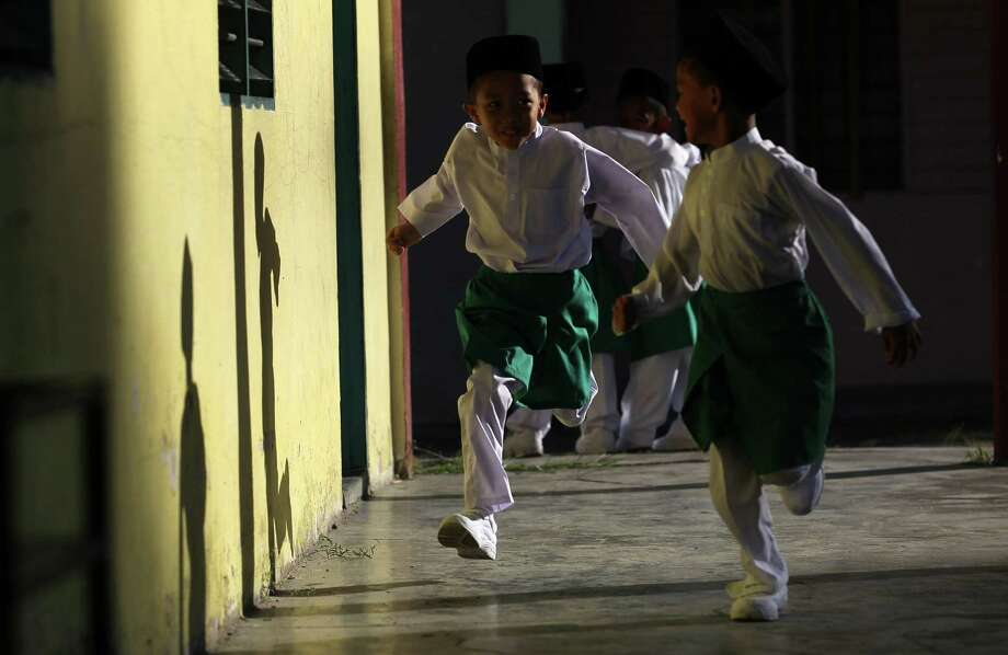 All kids need some time to run around and burn off energy. Here, students run outside a classroom during the first day of school in Kuala Lumpur, Malaysia, on Jan. 4. Photo: MOHD RASFAN, AFP/Getty Images / 2012 AFP