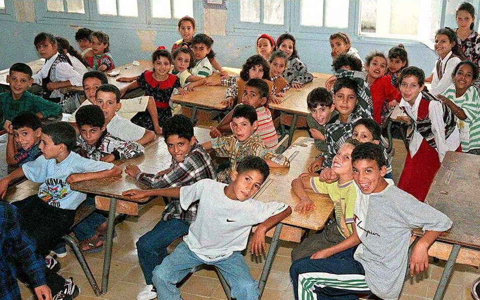 Algerian schoolchildren attend the first day of the school year in the city of Boufarik on Sept. 9,