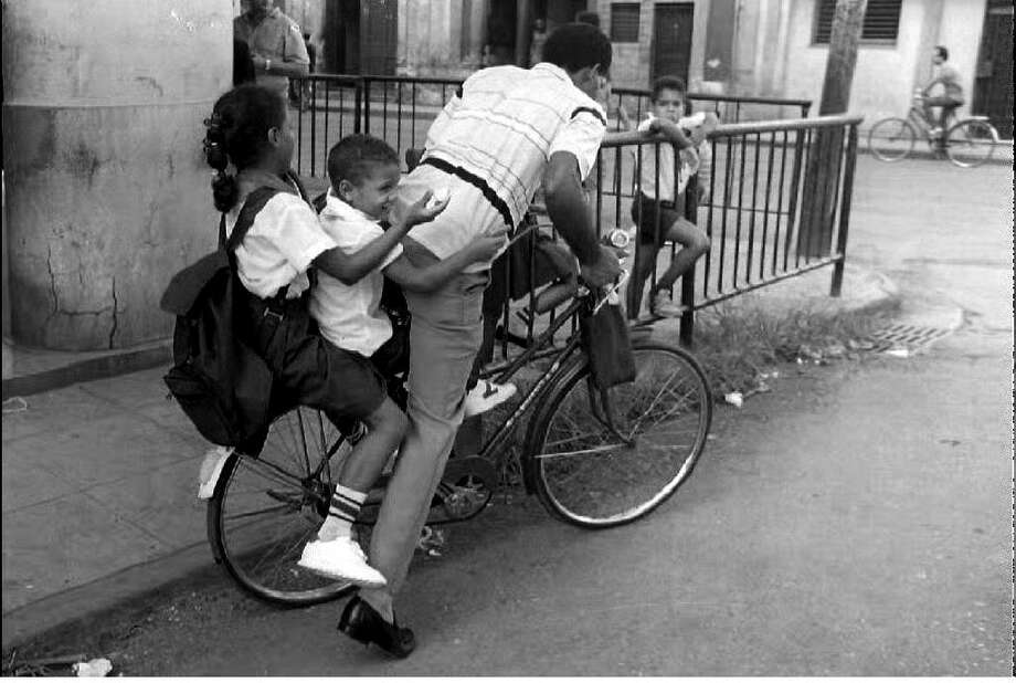 A Havana resident picks his children up from school Sept. 1, 1993 after the first day of school. Photo: ADALBERTO ROQUE, AFP/Getty Images
