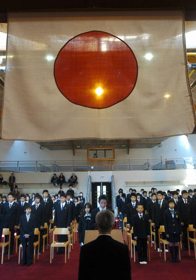 Students salute their director, Akira Tanaka, on the first day of classes at the Konan Japanese school in Tours, France, on April 7, 2006. Photo: ALAIN JOCARD, AFP/Getty Images