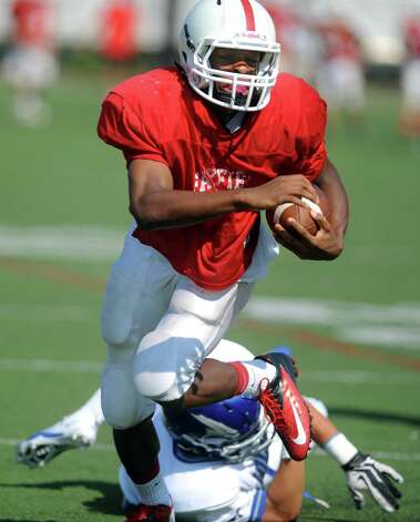 Fairfield Prep's John Moten avoids a tackle during a preseason scrimmage against Fairfield Ludlowe High School Saturday, Sept. 1, 2012 at Alumni Field in Fairfield, Conn. Photo: Autumn Driscoll / Connecticut Post