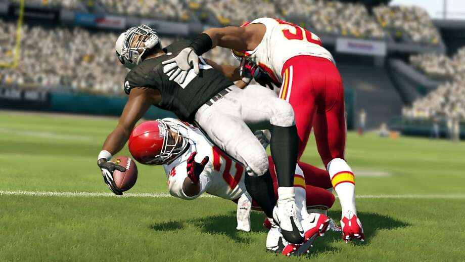 "Raiders running back Darren McFadden gets leveled after a realistic-looking run in the new ""Madden NFL 13"" video game. Photo: EA Sports"