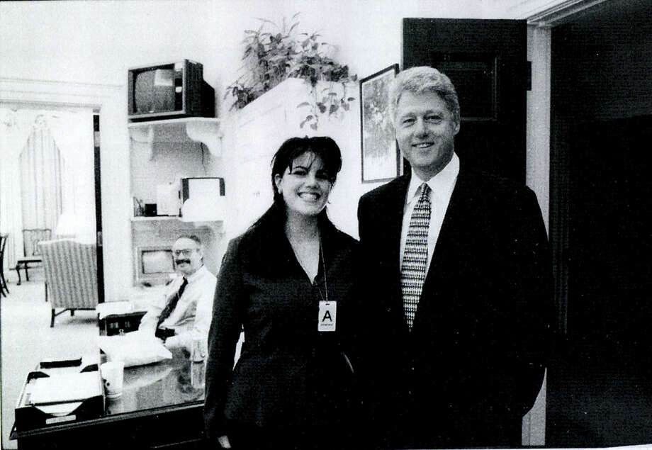 A photograph showing former White House intern Monica Lewinsky meeting President Bill Clinton at a White House function submitted as evidence in documents by the Starr investigation and released by the House Judiciary committee September 21, 1998. Photo: Getty Images