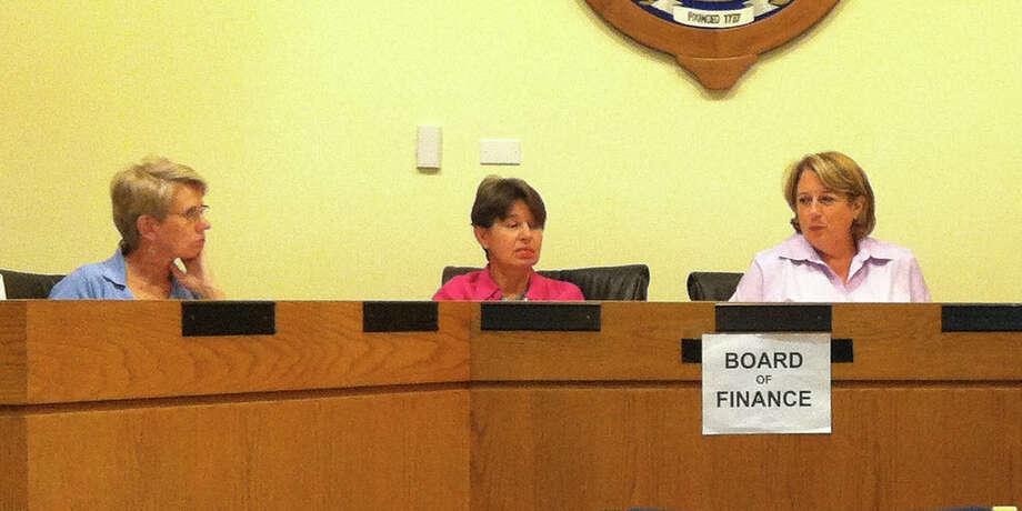 Gwen Mogenson, Martha Banks, and Elizabeth Mao discuss money transfers at the Aug. 30 Board of Finance meeting in Darien, Conn. Photo: Megan Davis