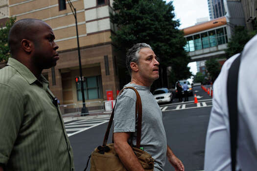 Jon Stewart, host of The Daily Show, walks through downtown Charlotte, NC before the Democratic National Convention on Tuesday, Sept. 4, 2012. Photo: Lisa Krantz, San Antonio Express-News / San Antonio Express-News