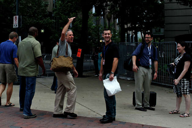 Jon Stewart, host of The Daily Show, jokes about his height after an onlooker made a comment as he walks through downtown Charlotte, NC before the Democratic National Convention on Tuesday, Sept. 4, 2012. Photo: Lisa Krantz, San Antonio Express-News / San Antonio Express-News