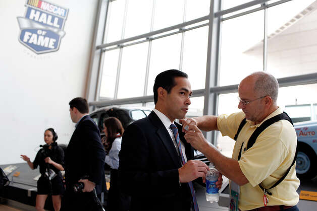 Mayor Julian Castro gets a microphone attached before being interviewed by Diane Sawyer for ABC World News at the Nascar Hall of Fame before the start of the Democratic National Convention in Charlotte, NC on Tuesday, Sept. 4, 2012. Photo: Lisa Krantz, San Antonio Express-News / San Antonio Express-News